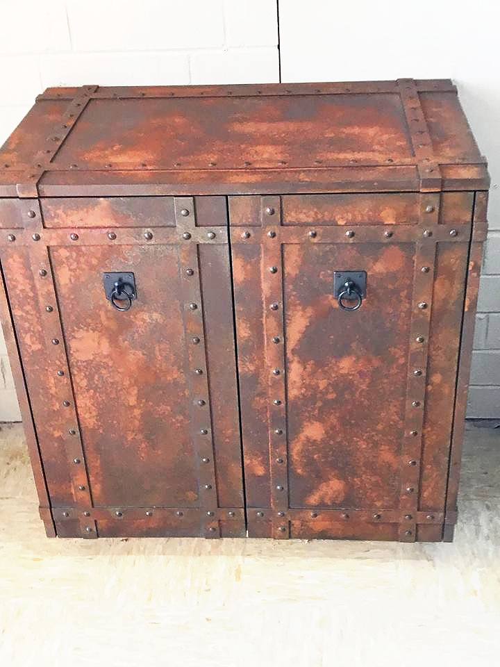 a cabinet covered in iron rust
