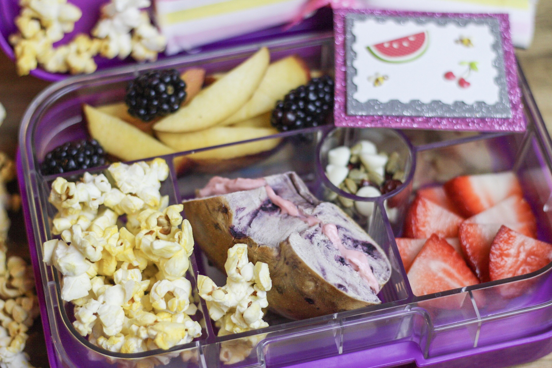 Bagel for lunch? We think yes! - Blueberry bagel with strawberry cream cheese, popcorn, strawberries, trail mix (yogurt covered raisins,sunflower seeds,chocolate chips), nectarines, and blackberries!