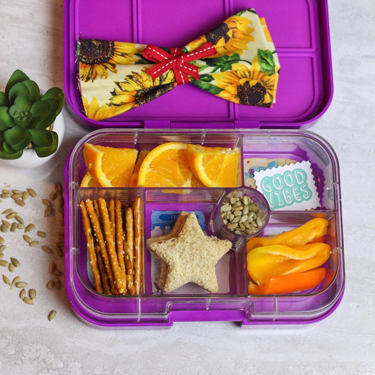 sweet peppers go a long way in our household! - PB and jam sandwiches, pretzel sticks, sweet peppers, sunflower seeds, and oranges!