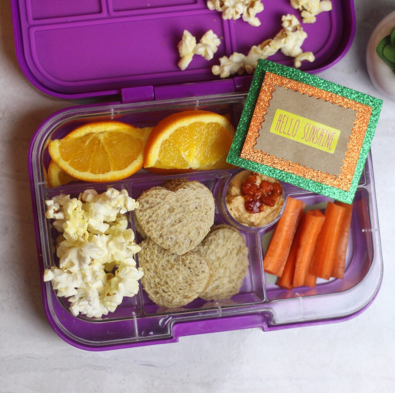 simple yet satisfying! - PB and jam sandwiches, carrots and hummus, oranges, and popcorn!