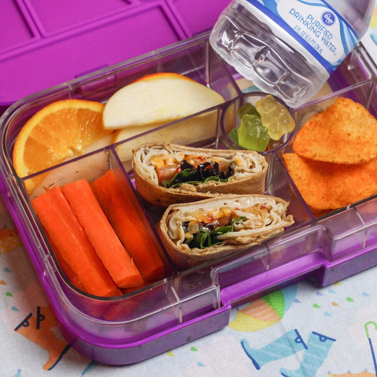 Turkey wraps for the win! - Whole wheat tortillas with turkey meat,spring mix,colby jack shredded cheese,tomatoes,and italian dressing….barbecue chips,carrots,oranges,apples,and fruit snacks!