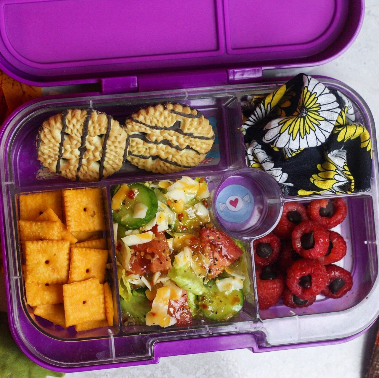 Salad for lunch is one of the most refreshing things ever! - Salad (crunchy romaine,roma tomatoes,mini cucumbers,colby jack cheese,ms dash,italian dressing), cheez its,raspberries with chocolate chips,and cookies!