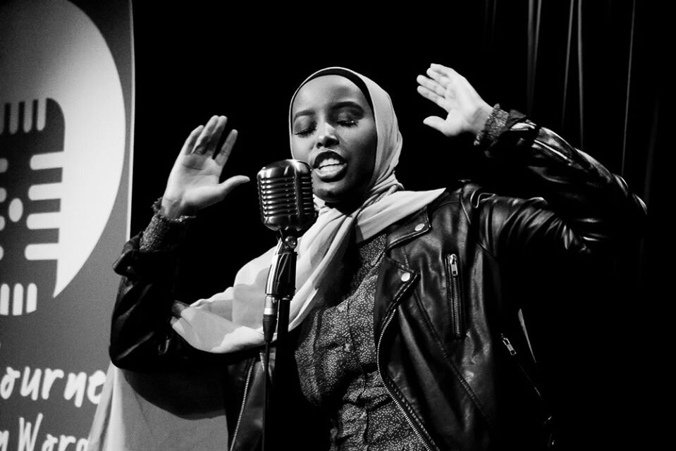 Zaynab performs at the Melbourne Spoken Word & Poetry Festival Opening Night. Photo credit: Brendan Bonsack.