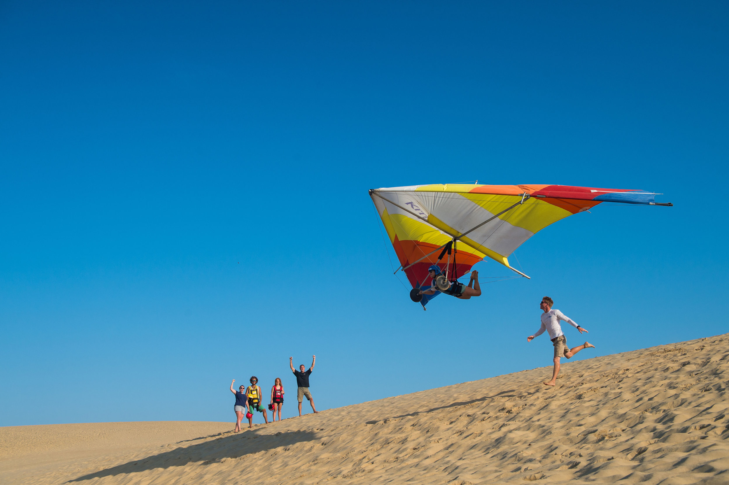Kitty Hawk Kites takes people out hang gliding near where the Wright Brothers had the world's first four successful motorized airplane flights at Kitty Hawk on North Carolina's Outer Banks. Courtesy of Kitty Hawk Kites.