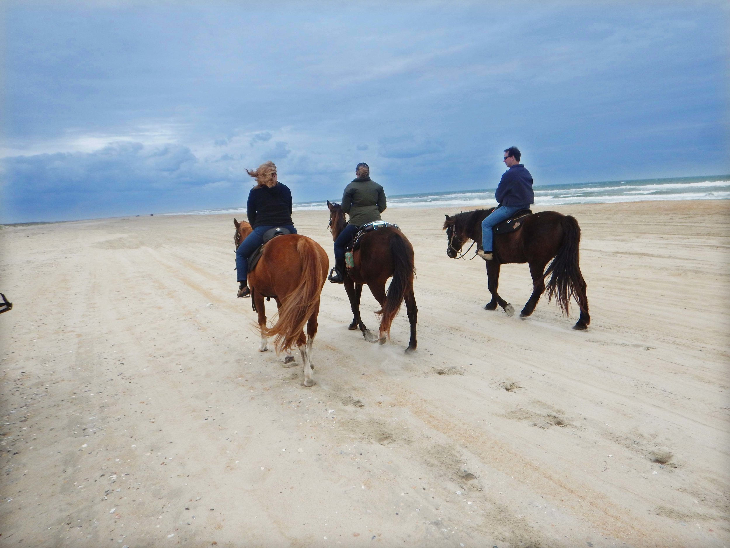 Equine Adventures takes groups horseback riding on Frisco Beach.
