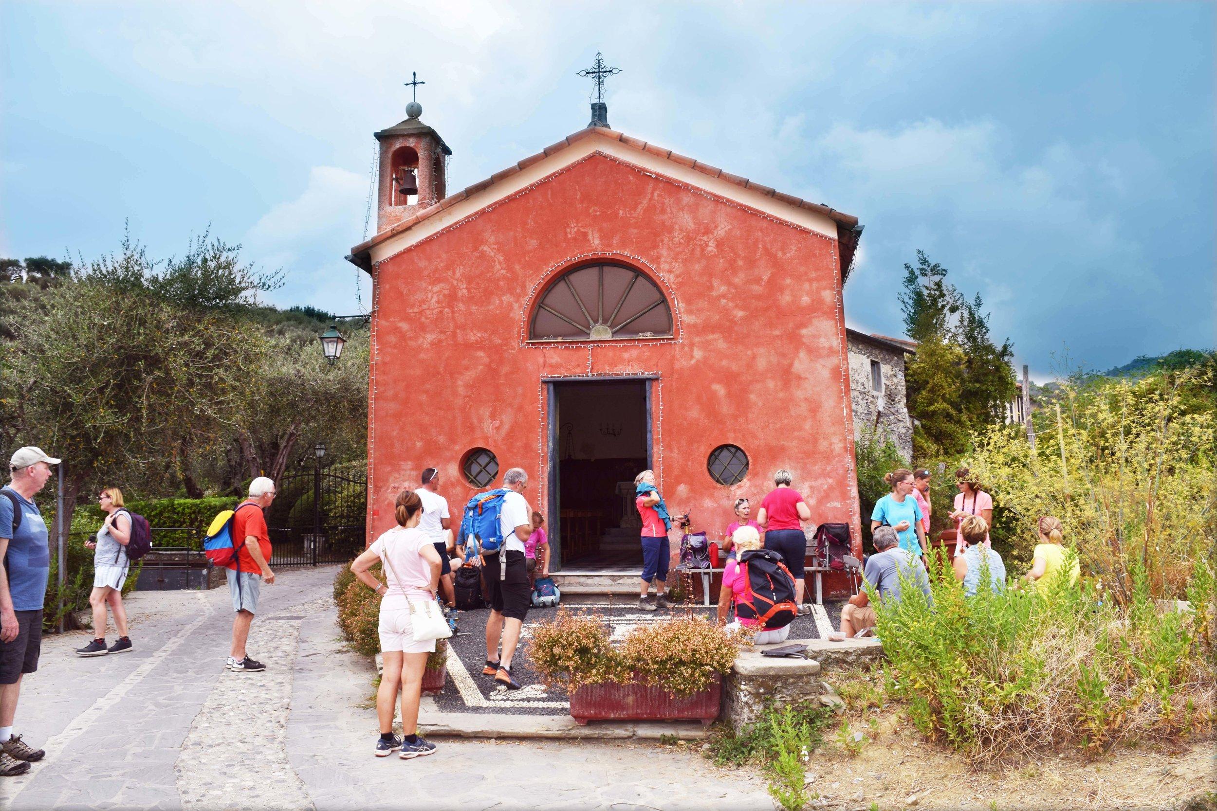 Hikers take a rest at the San Sebastiano Church.