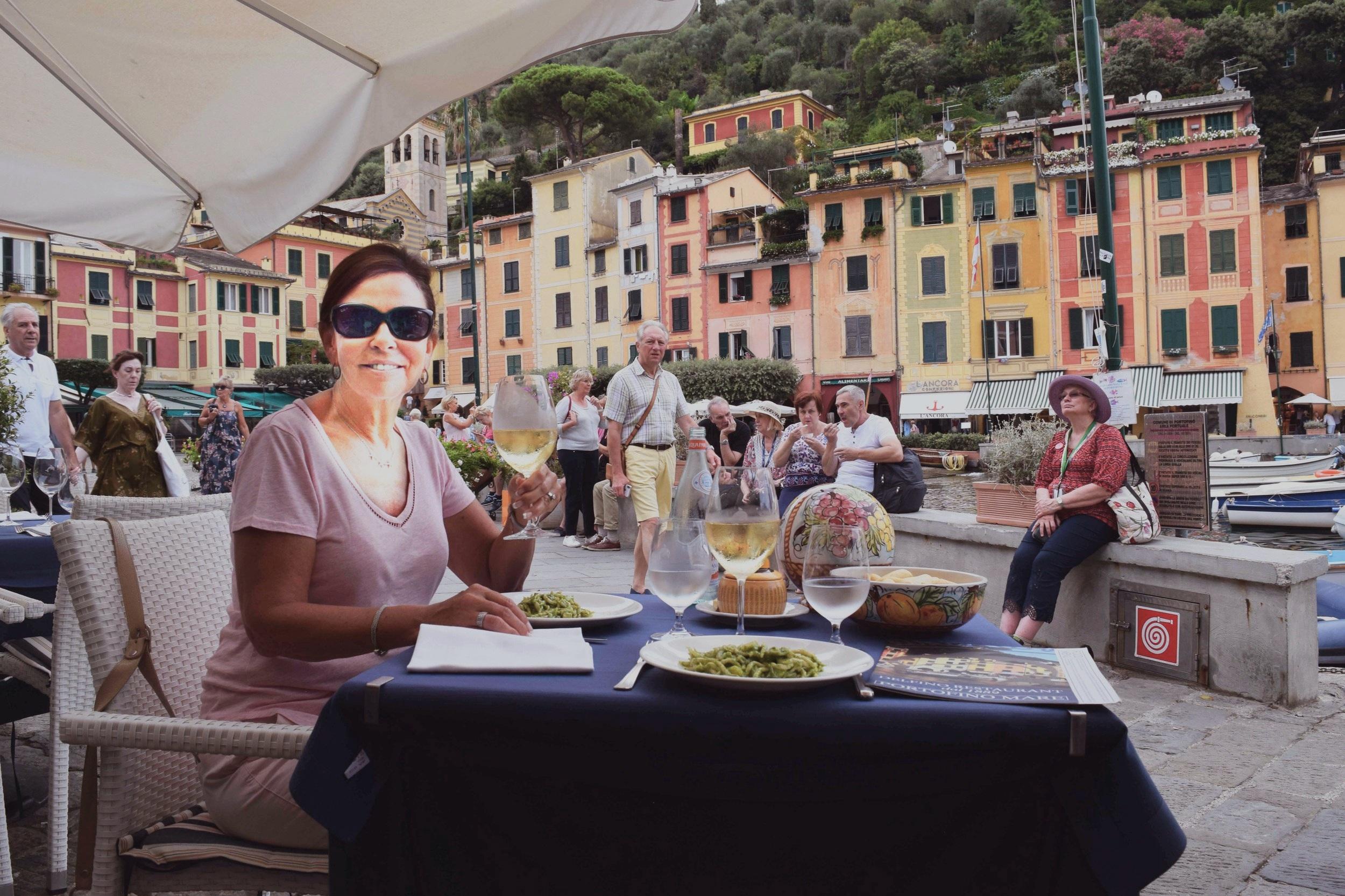 A lunch of trofietta pasta and Vermentino white wine at Delfino Restaurant in Portofino.
