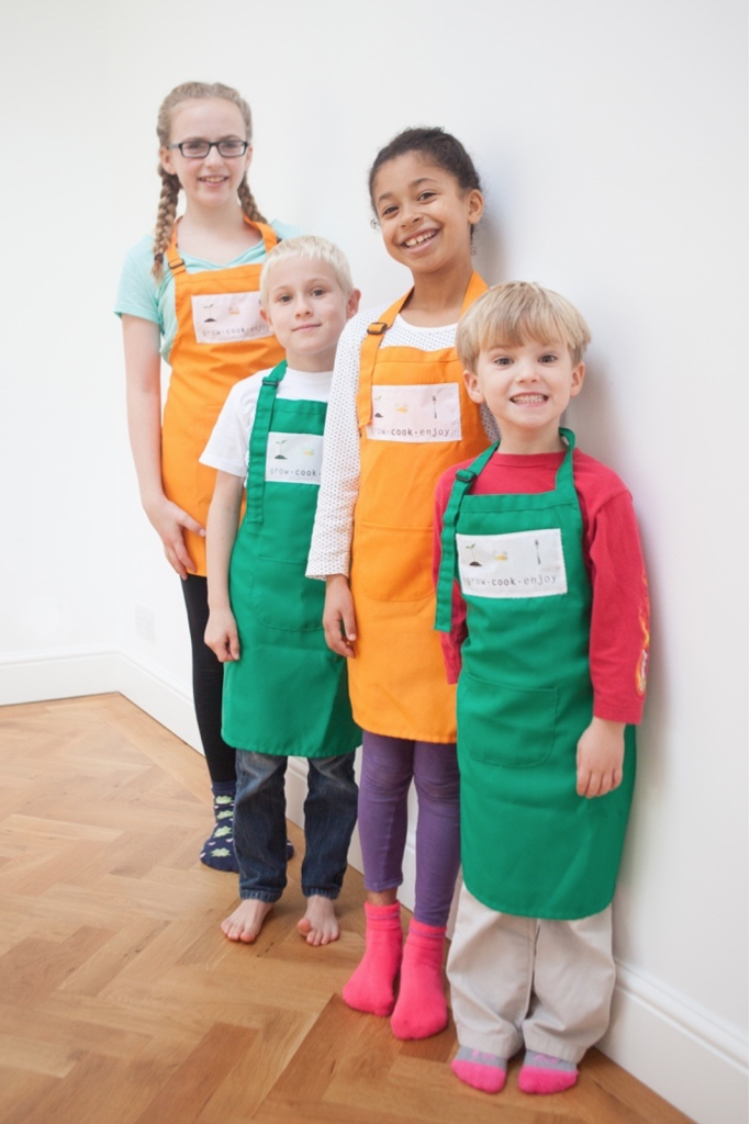Children Standing in a line waiting to start a Grow Cook Enjoy class