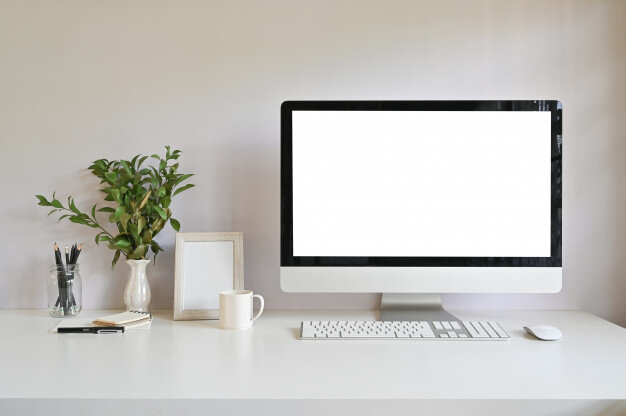 workspace-computer-photo-frame-coffee-with-plant-decoration-office-desk_35674-941.jpg