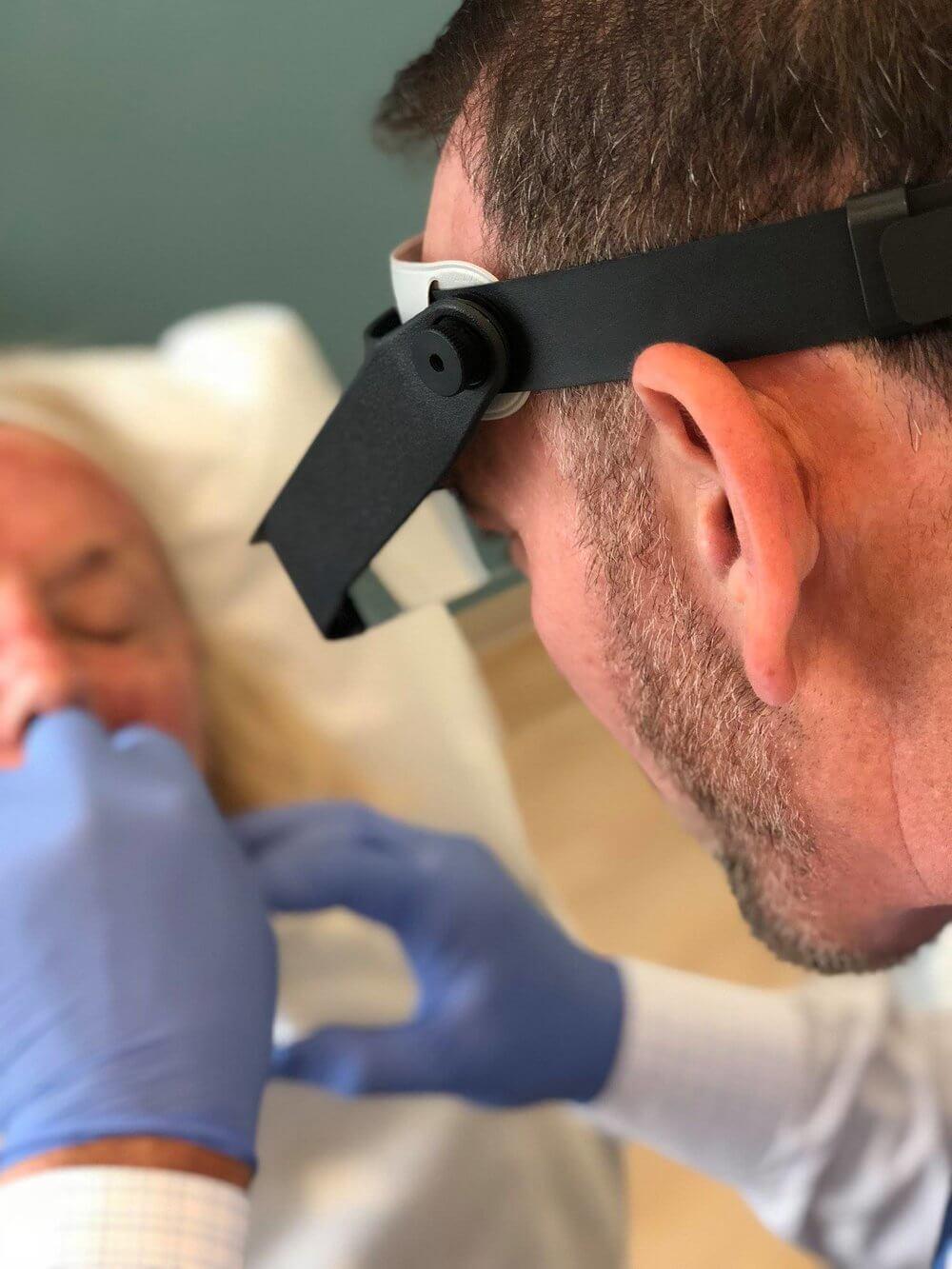 Dr. Petteruti using Restylane to fill the beautiful woman's lips.