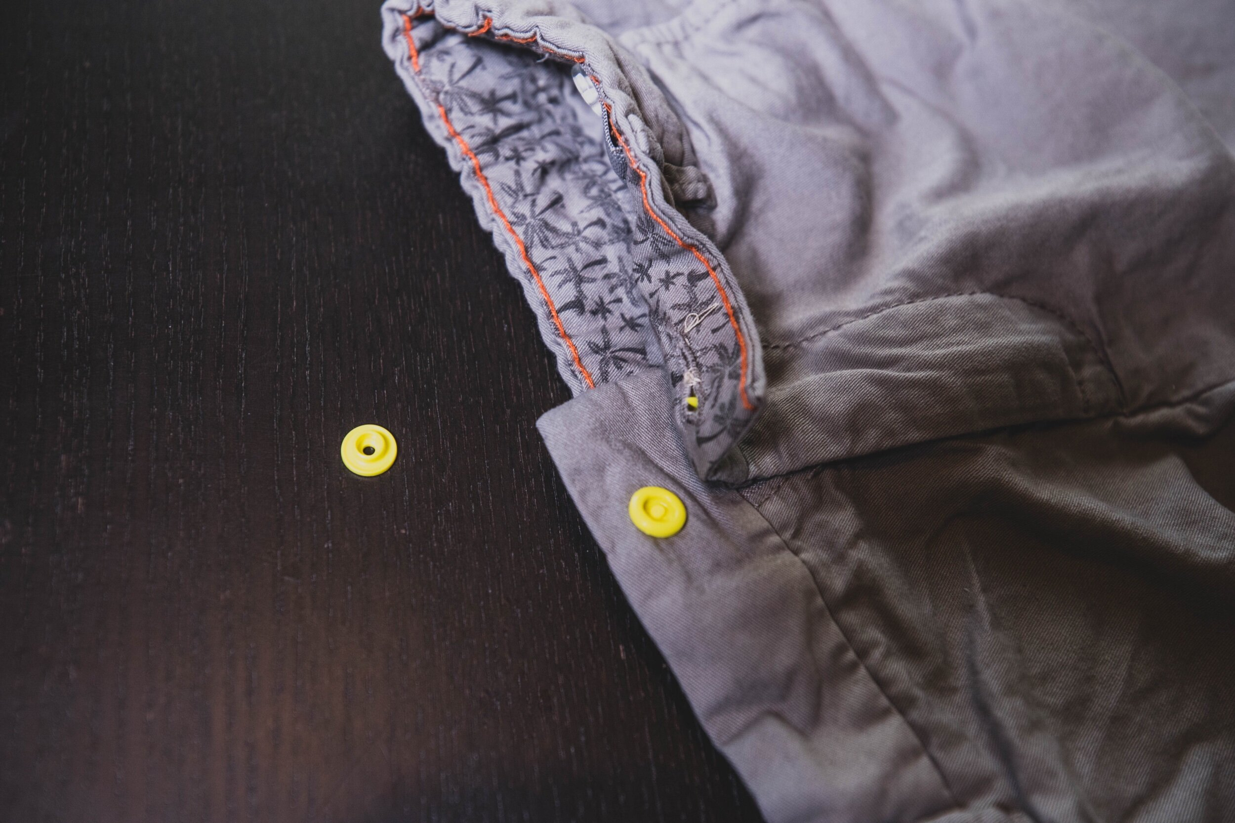 slide base of the snap into the hole of the button slit that you didn't sew up.