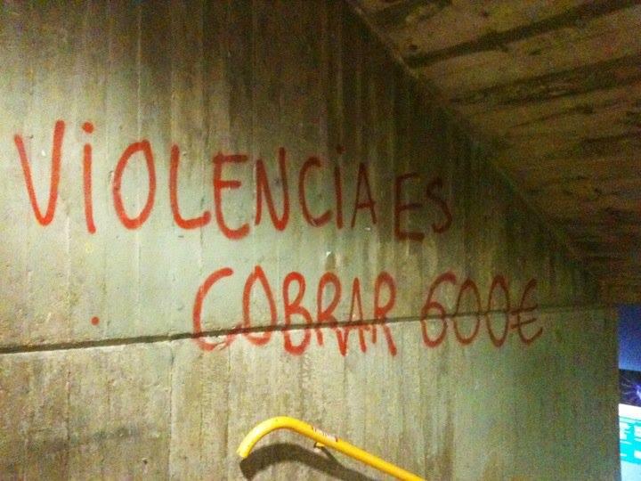 Pintada en pared que dice:  Violencia es cobrar 600 euros