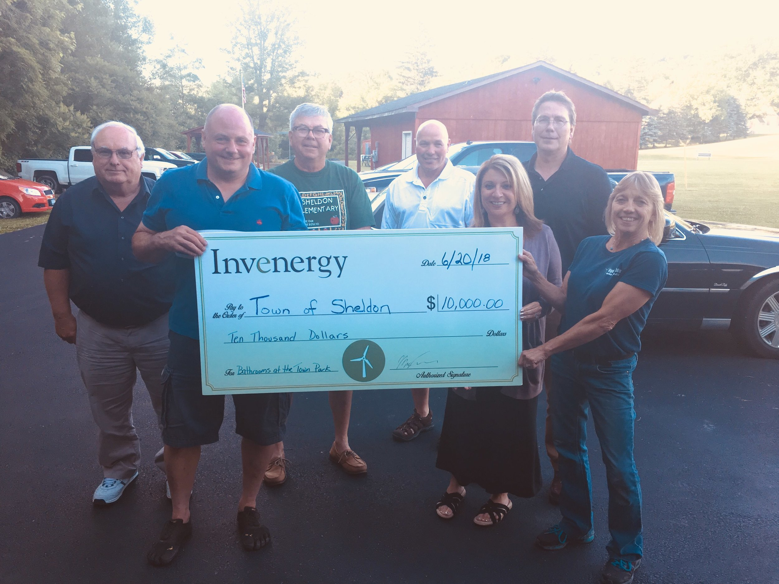 June 20, 2018:  A check presentation from Invenergy to the Sheldon Town Board to pay for remodeled bathrooms for the town park. Invenergy donated $5,000 on behalf of Sheldon Wind Energy Center and $5,000 on behalf of Orangeville Wind Energy Center.
