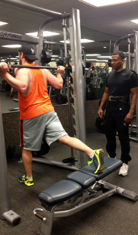 Dr. Chin observes strength training and form to support an injury-free recovery