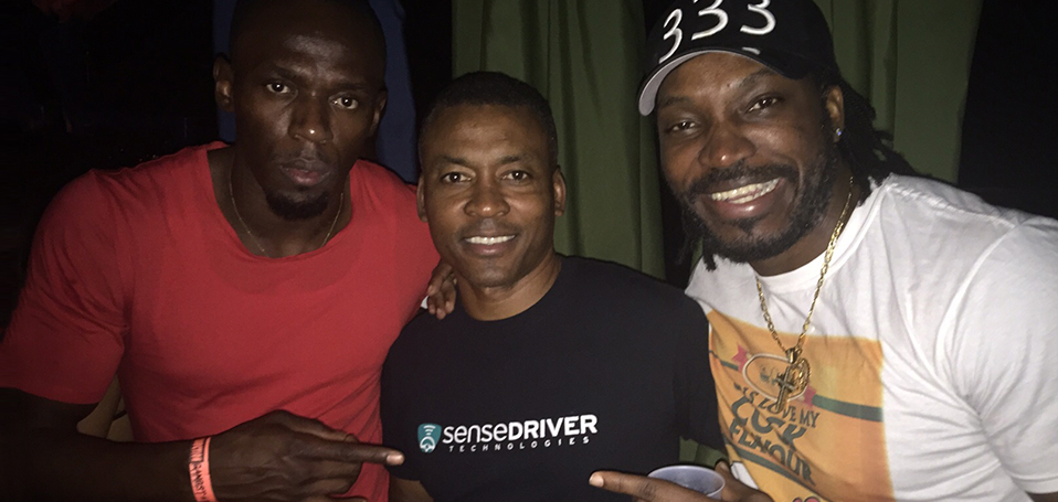 Usain Bolt, Dr. Chin and Chris Gayle share a moment in Montego Bay.