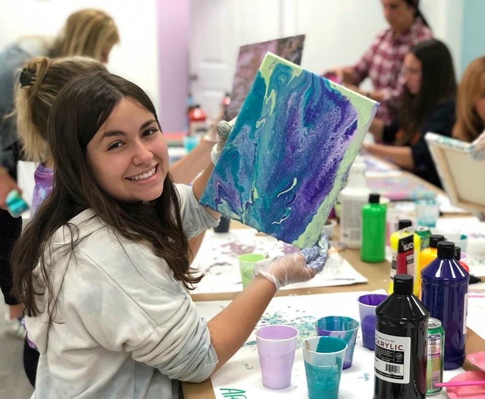 Ari S. at a KALLIRAES paint pour class