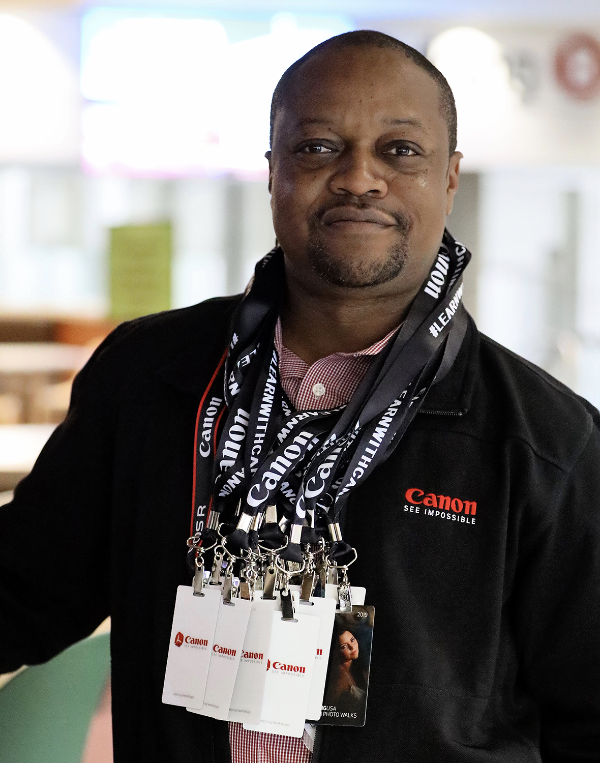 Here I am at a Canon Live Learning photo walk at Imaging USA. I was handing out badges to our attendees.