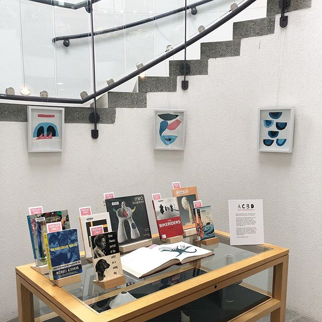 """through the month of may, i'll have some paintings + ceramics along with ten book recommendations on display at @portsmouthpubliclibrary as part of their """"artist curated book display"""" program. libraries rule."""