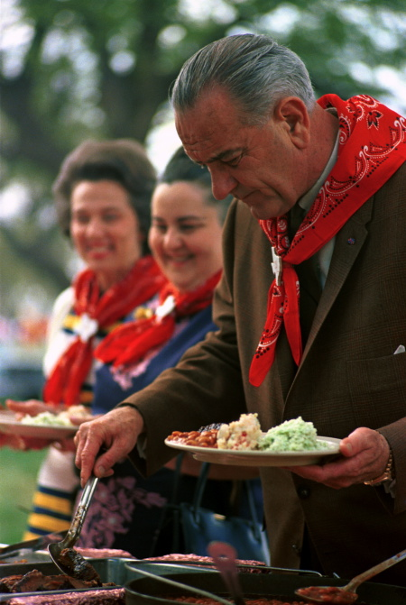 President Johnson getting some barbecue at Latin American Ambassadors Weekend on the ranch. LBJ Library photo by Yoichi Okamoto, Apr. 1, 1967