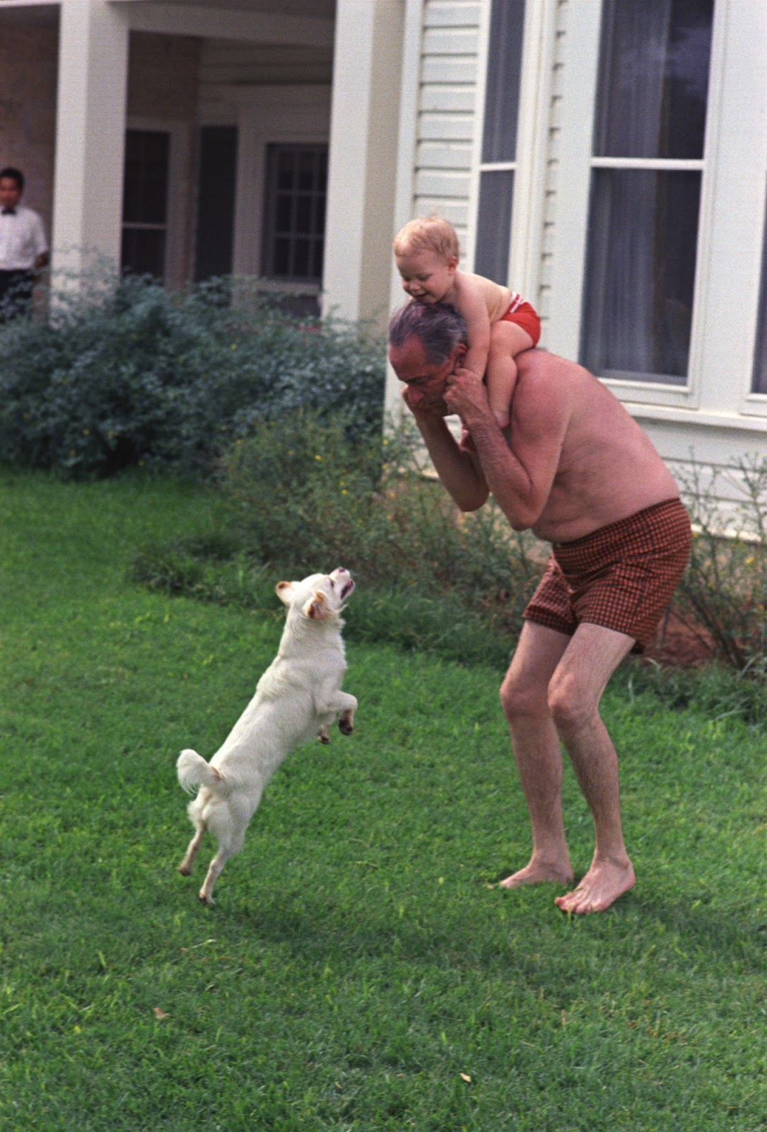 President Johnson with grandson Lyn and dog Yuki on the ranch. LBJ Library photo by Mike Geissinger, June 1, 1968