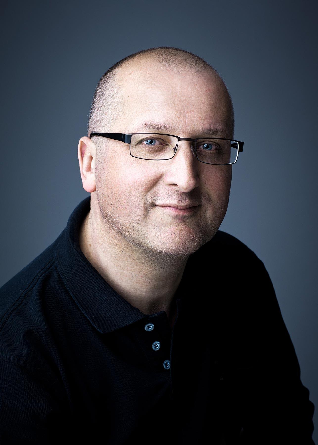 Headshot-Man-glasses.jpg