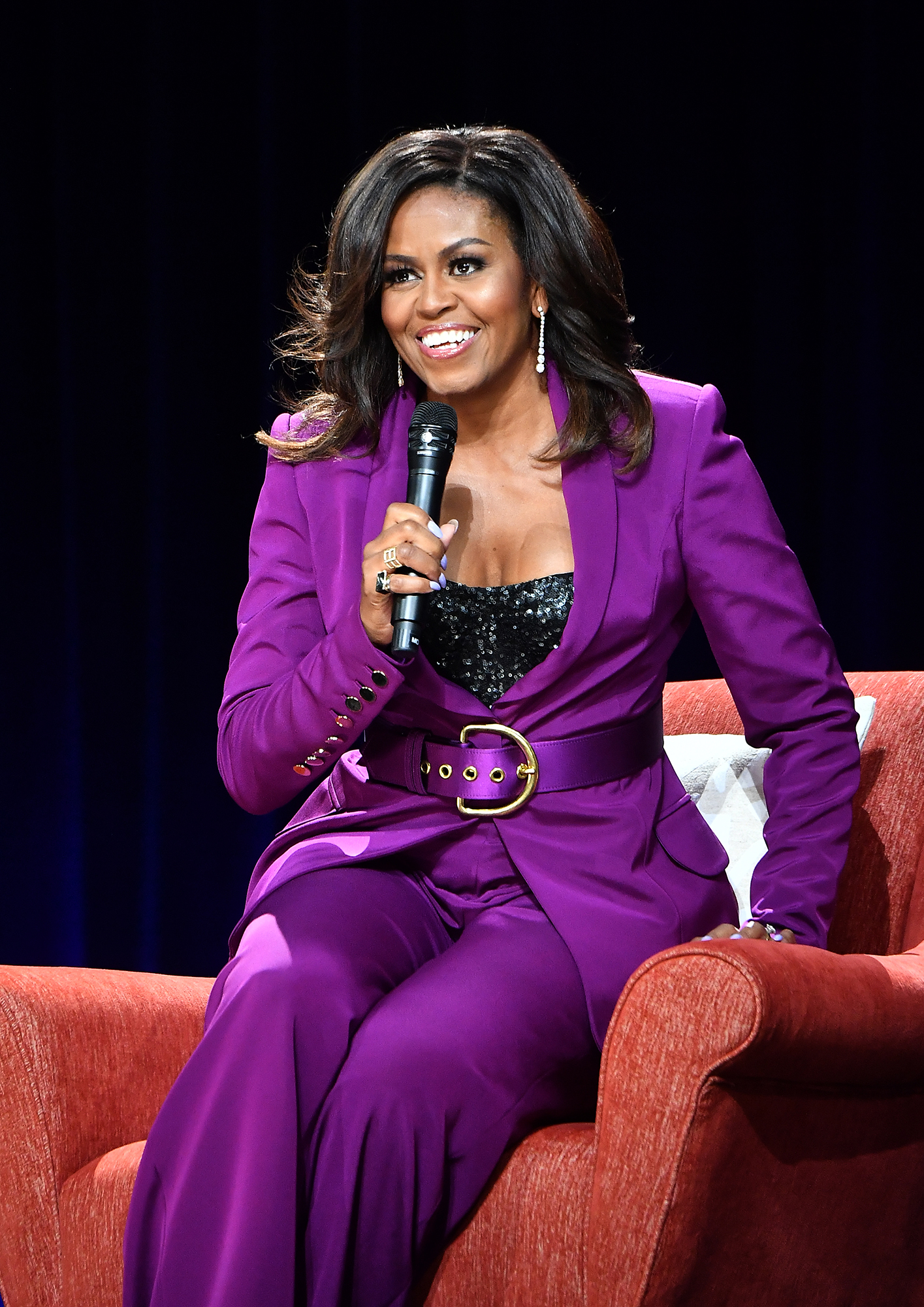 Michelle Obama rocking a bright purple pant suit. Photo: 2019 Paras Griffin