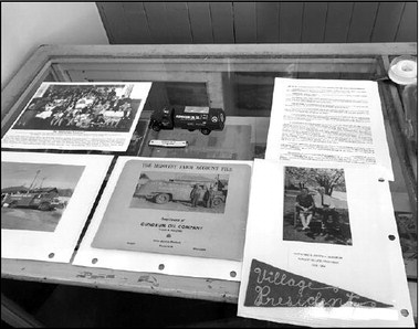 This display at the old Slinger train depot looks back at the public career of former Village President