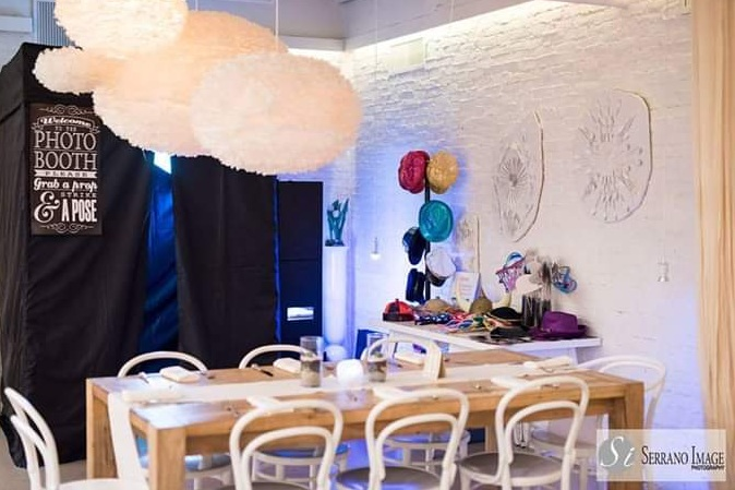 Mojo - Enclosed Booth - Our Enclosed Booth is perfect if you and your guests want a little bit of privacy. Technically I have to tell you it can fit about 8 people, but our record is closer to 15. Guests can choose color or black and white and it's just all around fun for everyone!