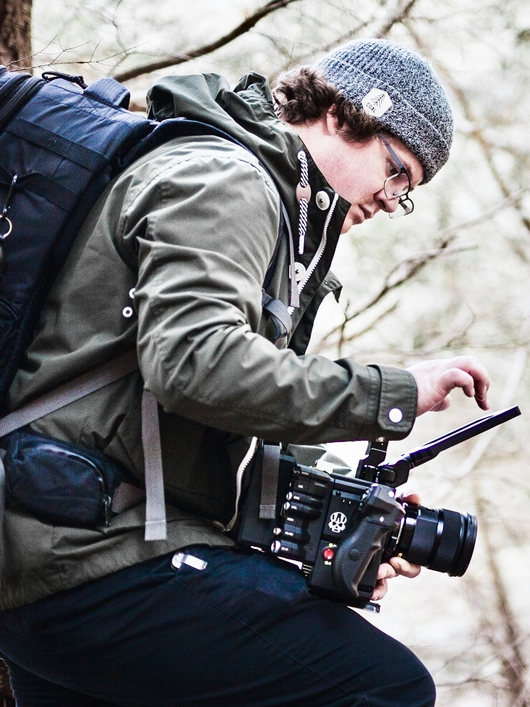 Cody reviewing footage on set.