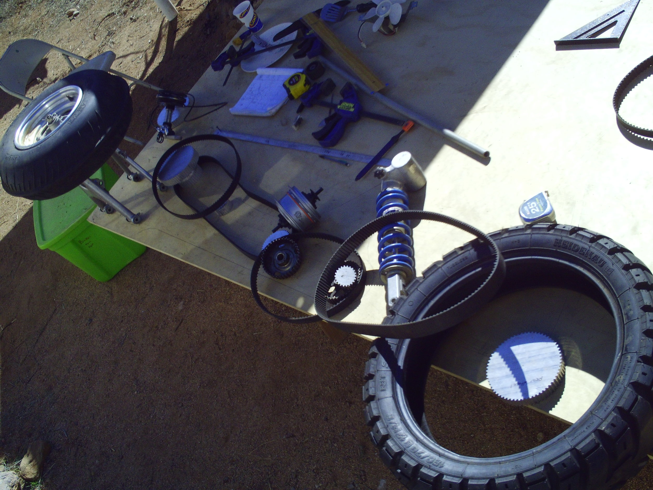 Bicycle and recycled components laid out in their basic drive configuration.