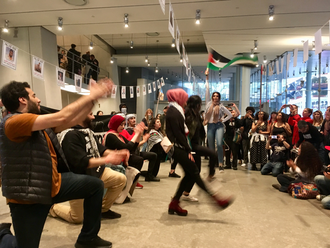 Members of Within Our Lifetime performing a Dabke flash mob in the lobby of the Whitney Museum on Friday April 19.