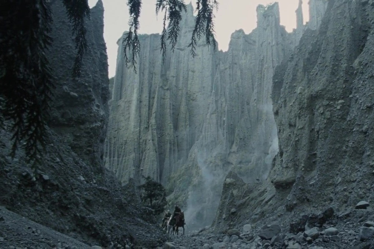 Aragorn, Gimli and Legolas on the Dimholt Road in The Return of the King.