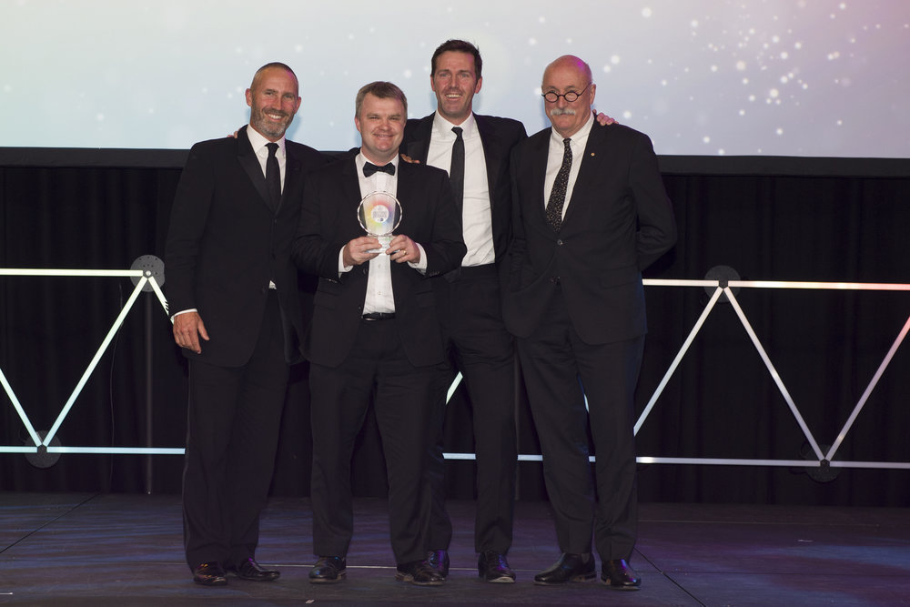 (From left to right)  James Robinson, John Leo and Adam Somerville accepting a Property Council of Australia award from Bob Nation (GHD Woodhead, Award Sponsor)