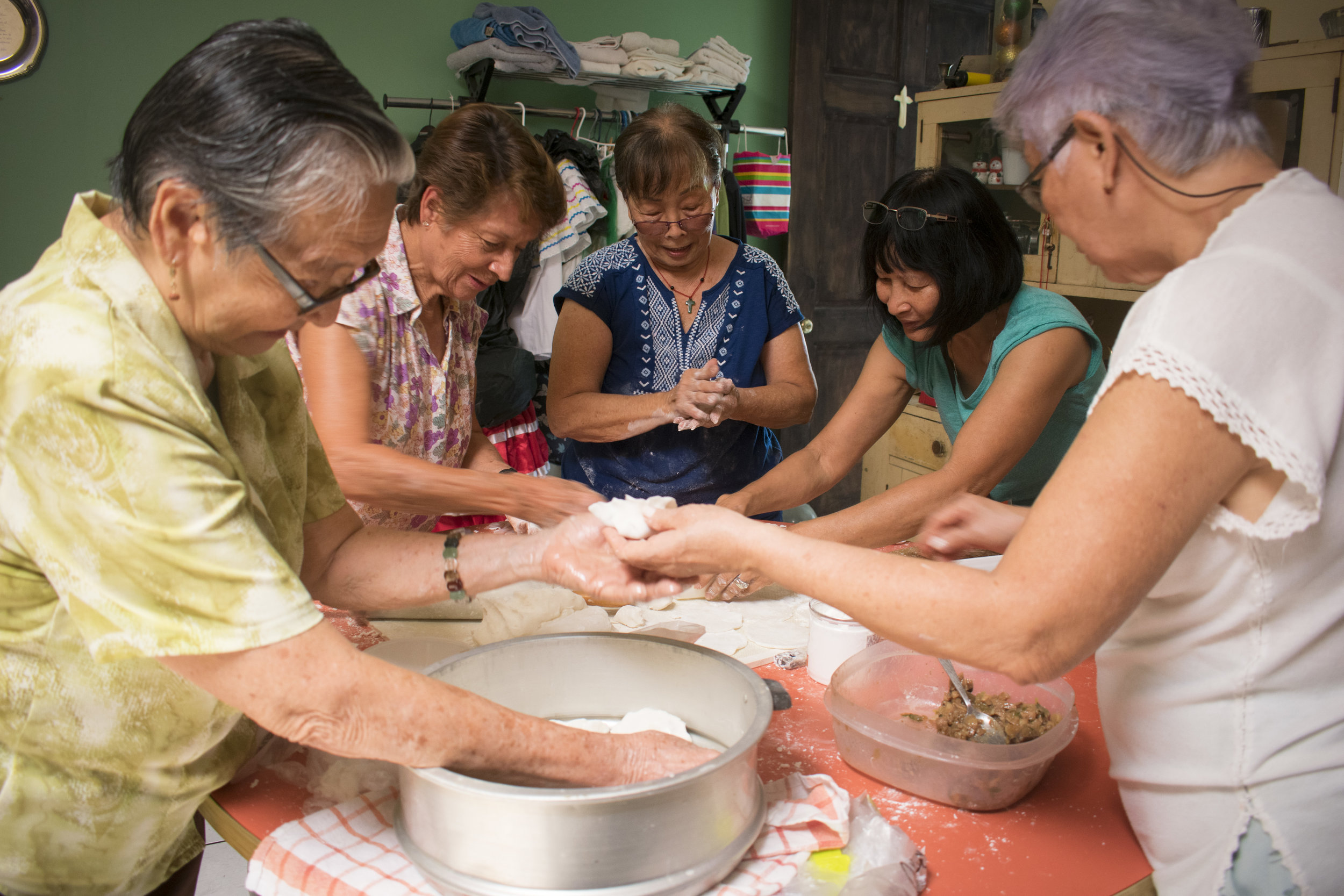 6.Las tías del quilting, a group of Flora's Friends and family that reunite each Thursday to quilt, gather to make har gao-- a type of Chinese dumpling.JPG