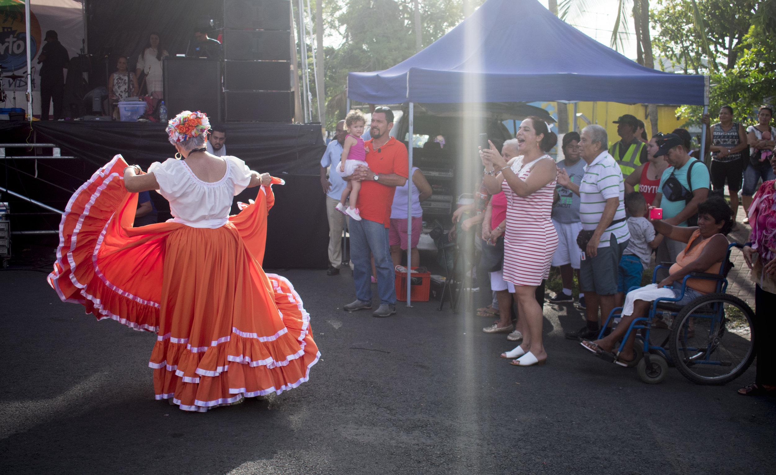 1._Retired educator Flora Ángela Li Cheng dances a baile típico with her senior dance group at a celebration for the Virgen del Mar. She is an avid dancer who enjoyed dancing paso dobles and boleros with her husband before he passed away..JPG