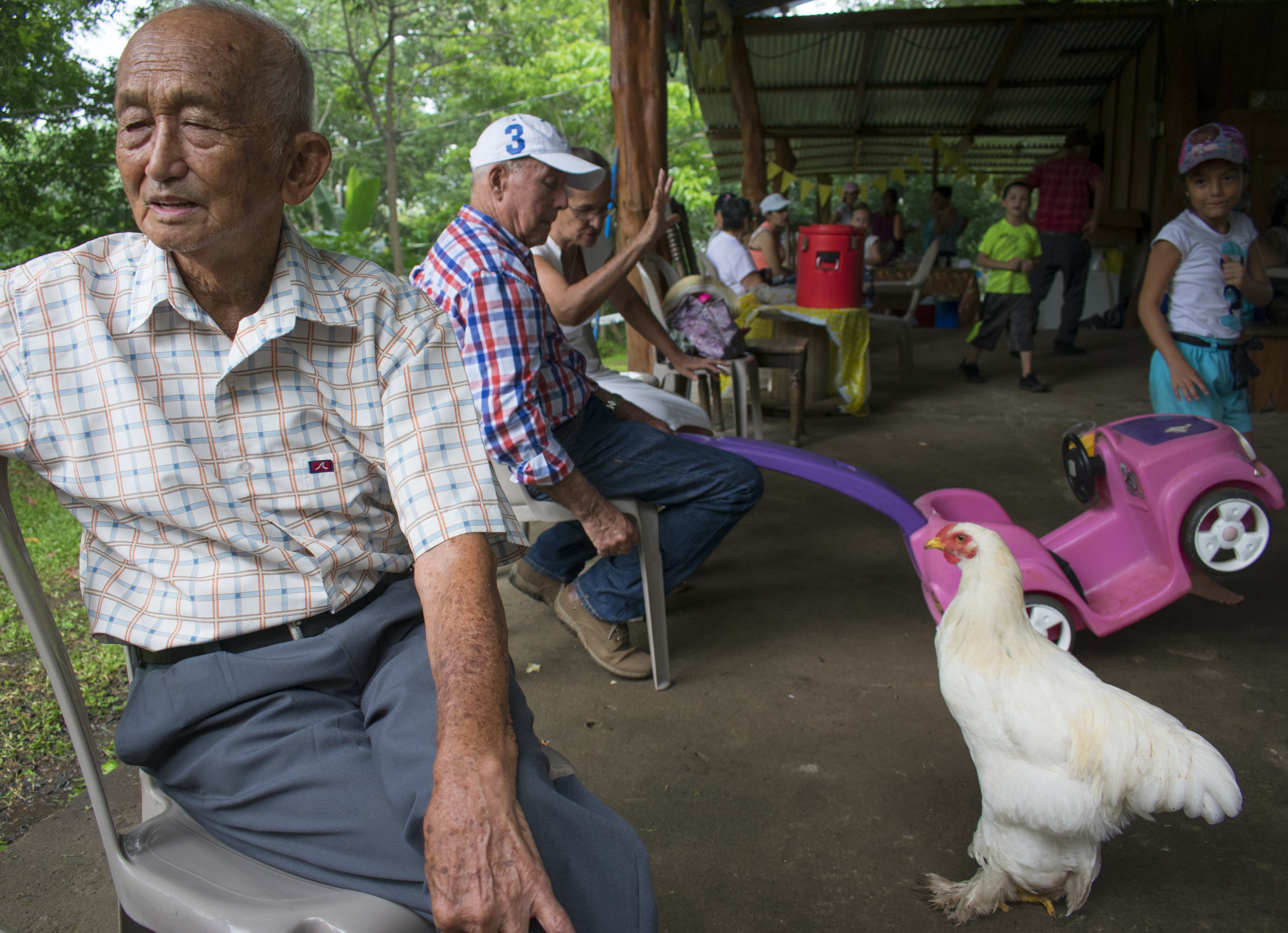 3. Hernán (Pipe) Chan rests at his farm after hosting a procession for his Virgen de los Ángeles, which was established to bring more religious awareness. Community members gathered at his house to enjoy Chinese food provided by the Chan .JPG