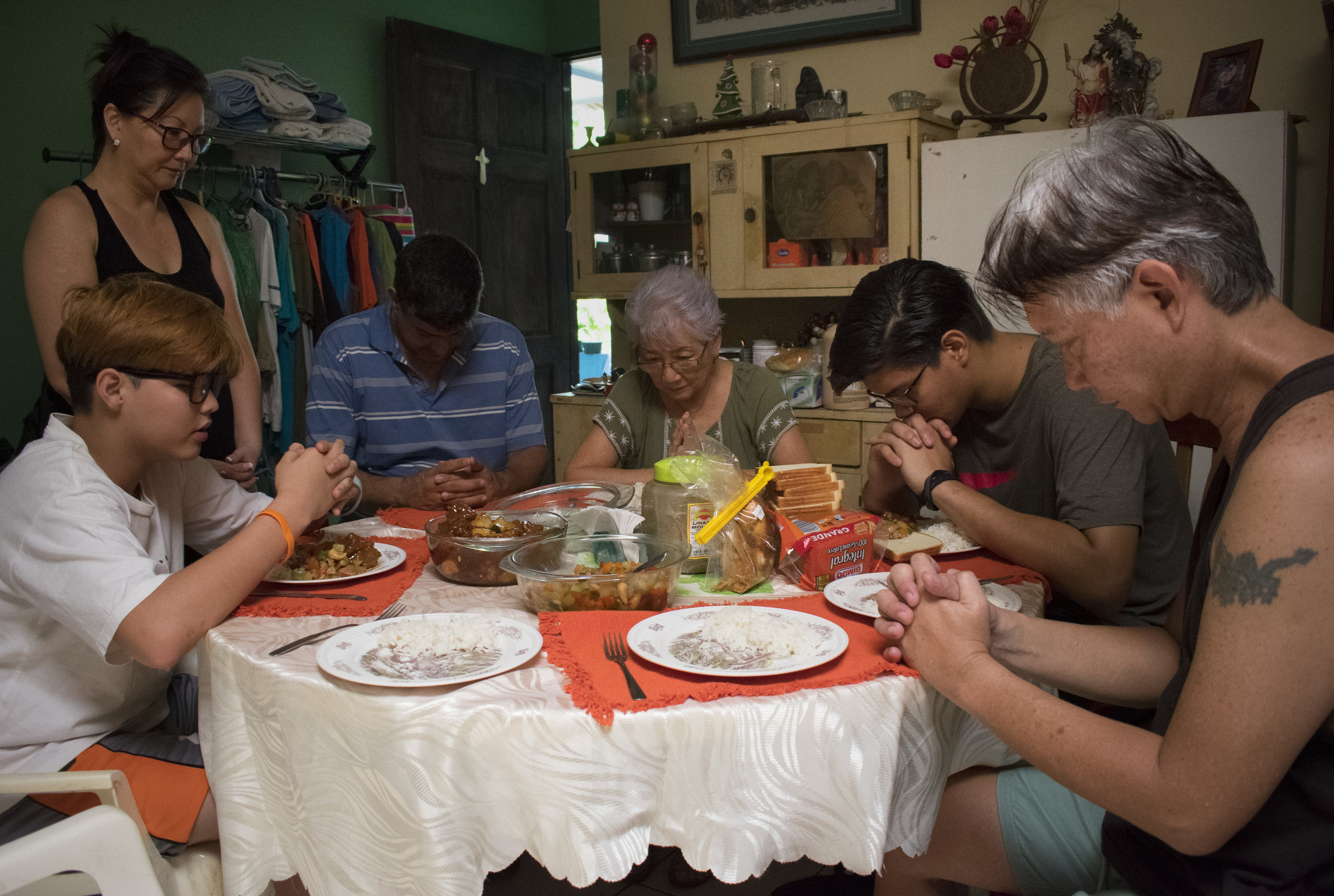 2. The Sánchez-Li family (L-R, Jose Manuel, Floriana, Mario González, Flora Ángela, Mario José, Róger) say grace before eating Chinese take out .JPG