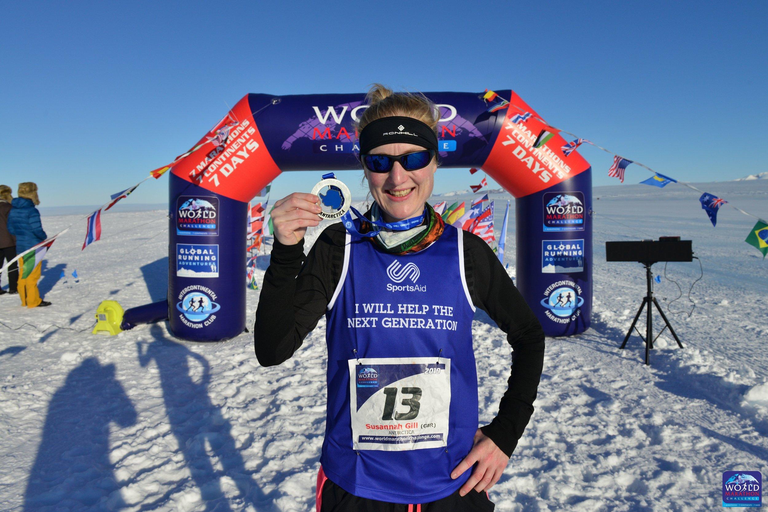 Susannah Gill wiht medal in Antarctica .jpg