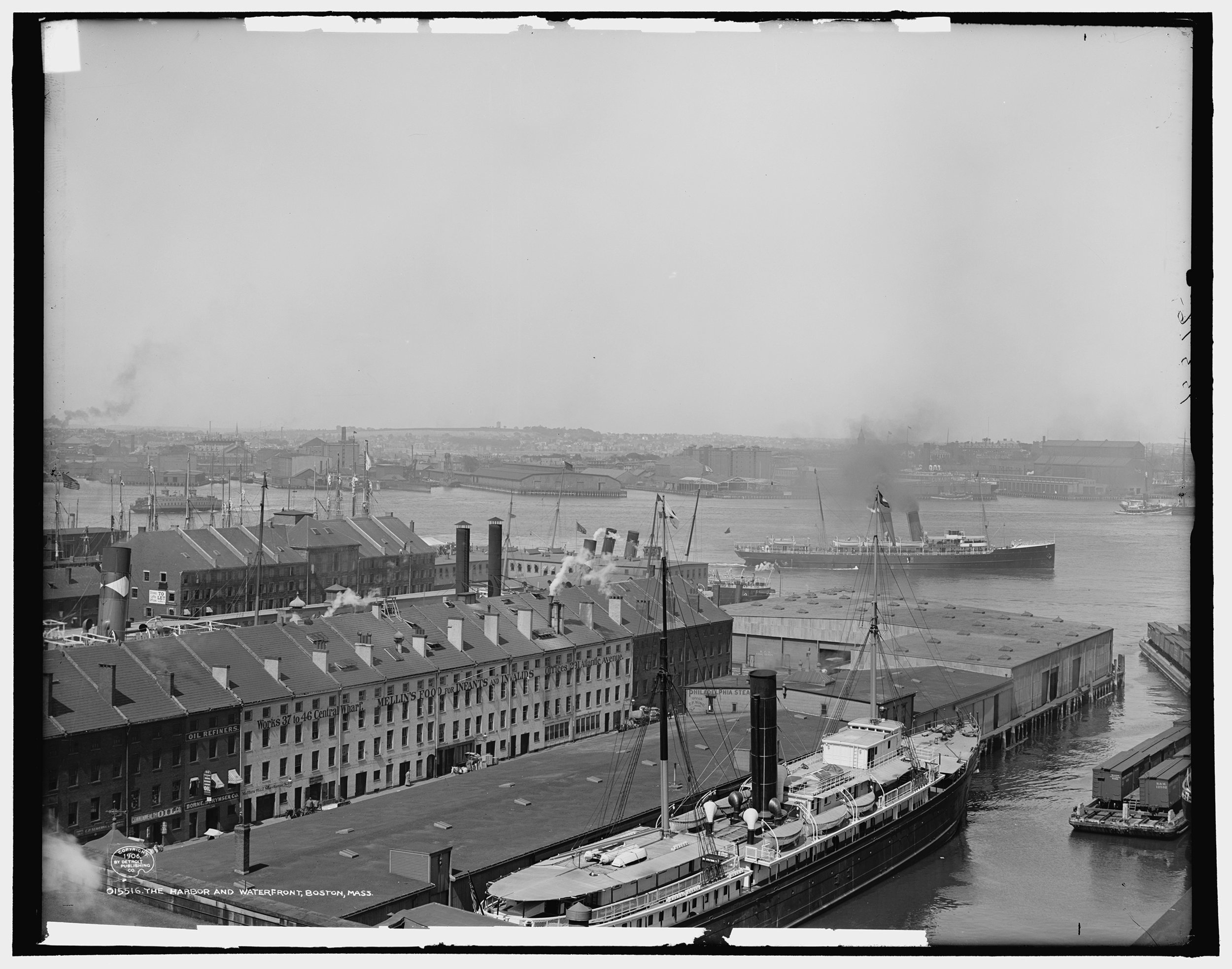 The Boston Harbor in ca. 1906, showing the Central Wharf (foreground) and Long Wharf. East Boston is visible in the distance.