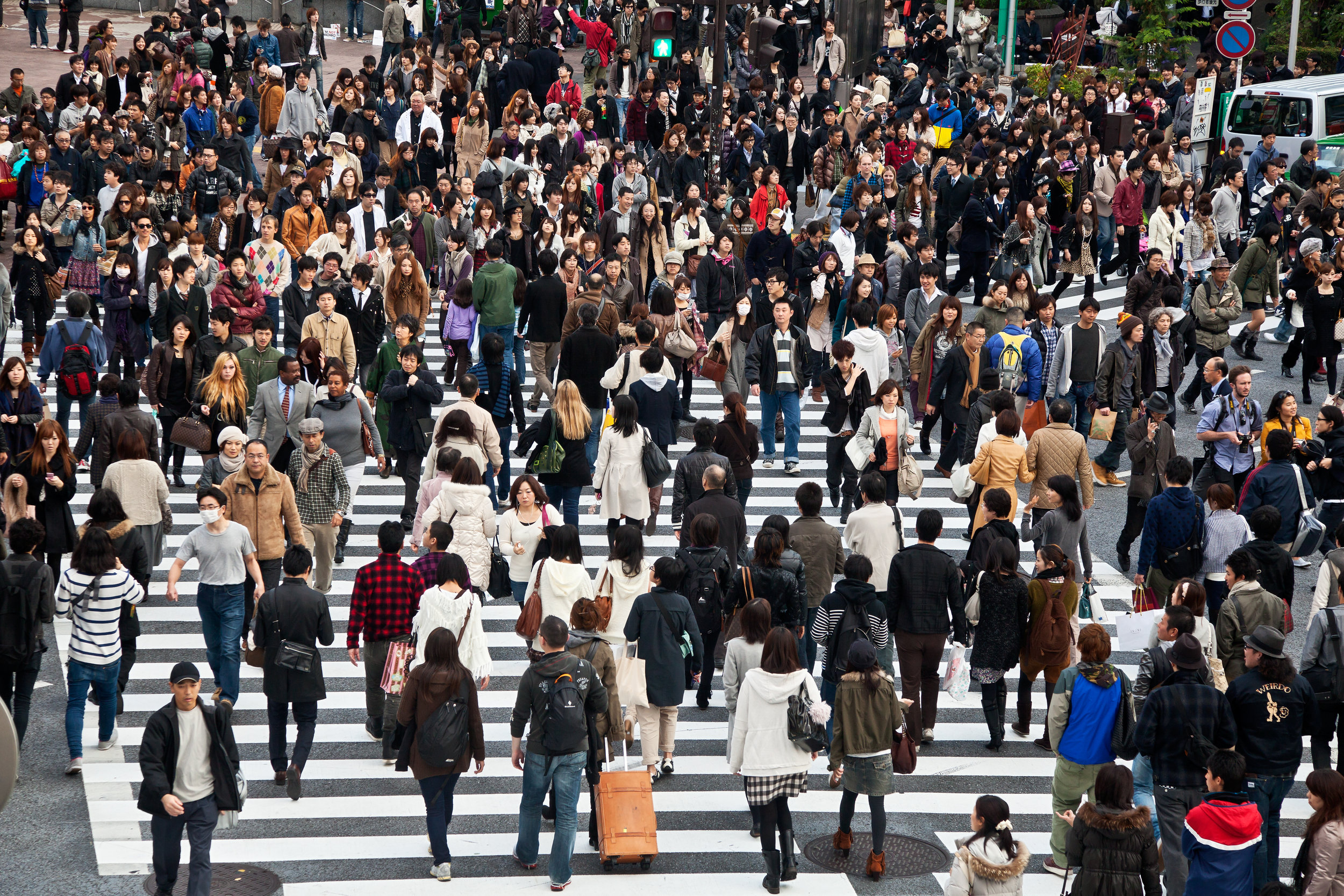 [Pedestrians at Shibuya crossing in Tokyo, Japan (the famous scramble crosswalk is used by over 2.5 million people daily) Photo credit: Thomas La Mela/Shutterstock.com]