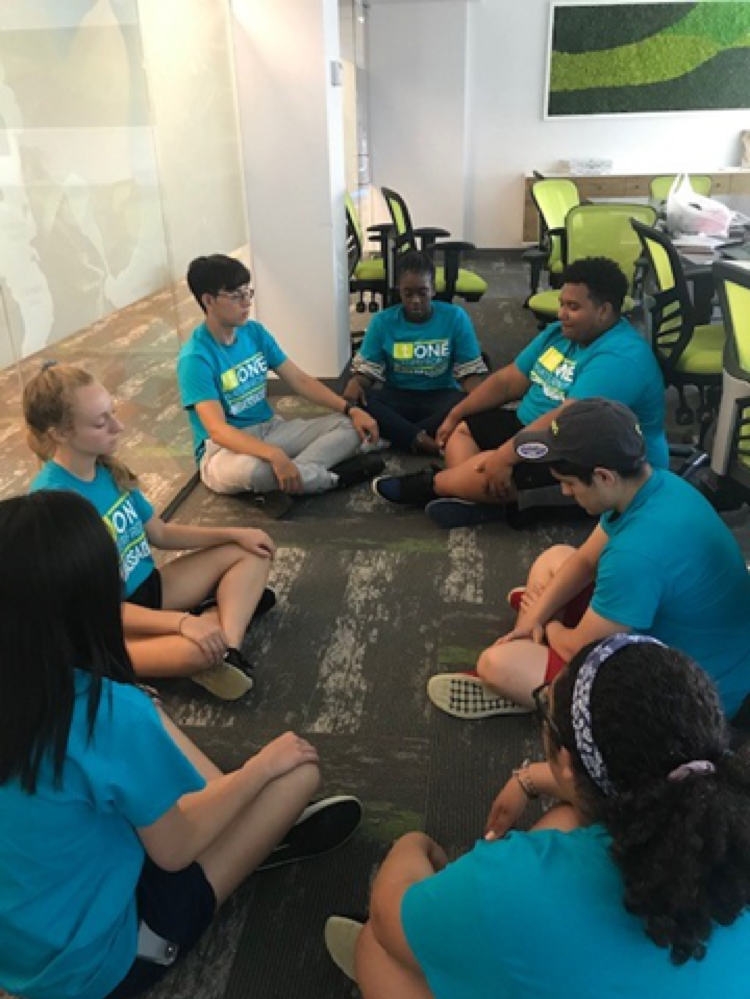 After a long day of work and fun, Ambassadors Assistant Program Manager Ashley takes the group through a few minutes of meditation.