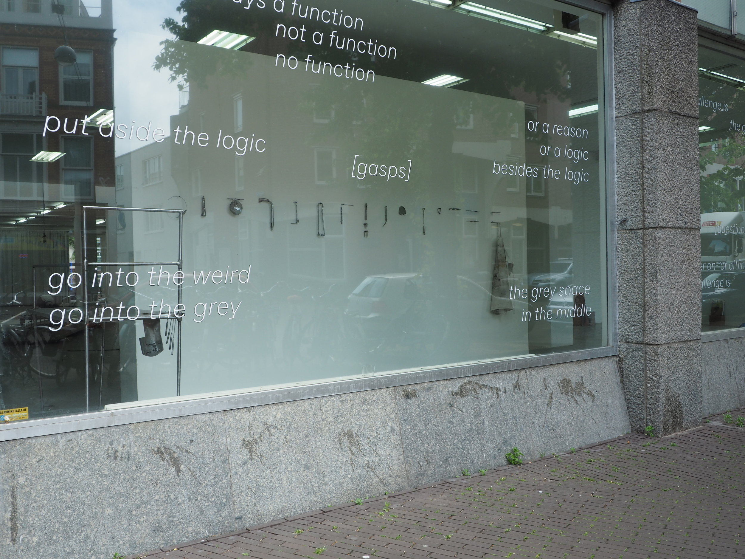 Caramelo ''it's in the fucking ocean'', The Grey Space In The Middle, The Hague 2017 Window text from The Grey Space In The Middle.