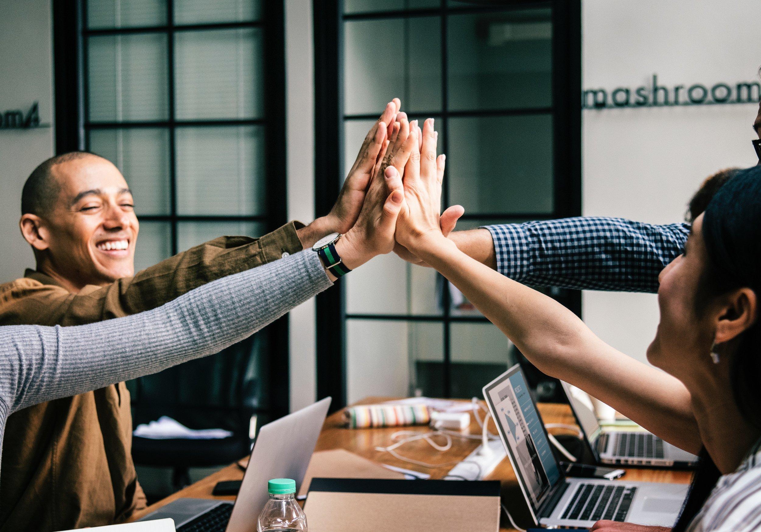 Business meeting handshake across the table