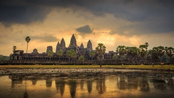 Raise A Glass To Angkor Wat   Drink in hand, watch the golden glow of a sun rise over the temples of Angkor Wat.