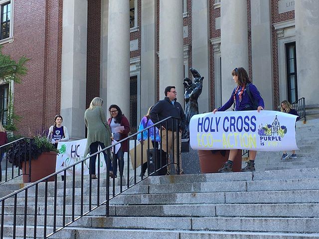 """""""Environmental activists gathered on the Dinand steps today, in front of the statue of Christ's Crucified Hand. Representatives from the Chaplain's office tried to hang one of their strike signs on the statue, but the wind blew it off...."""" To read more on the Climate Strike, click the link in our bio. Article and photographs by Matthew Corrigan '21"""