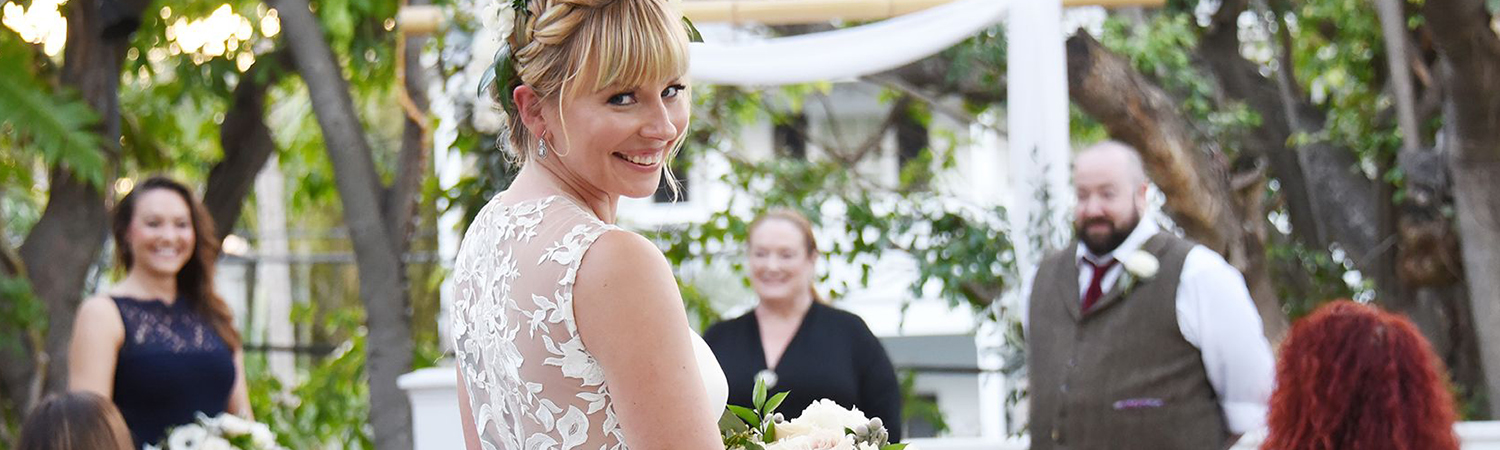 a happy bride about to walk down the aisle during her intimate ceremony in First Flight's Treetop Terrace.