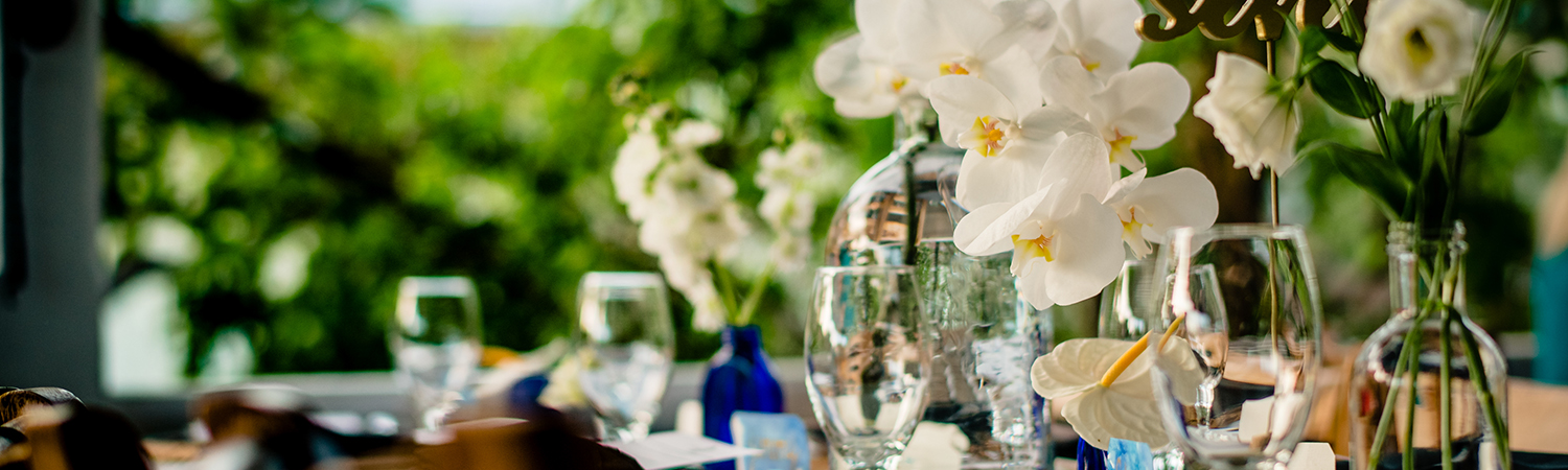 elegant table settings await their guests for a reception with a view on the Bagatelle balcony