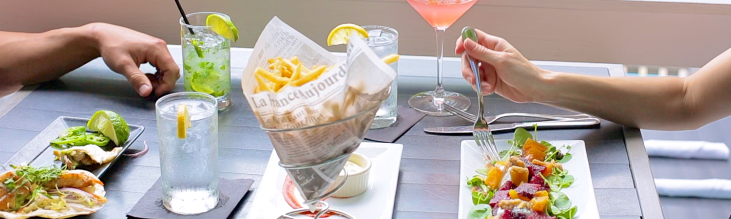 delicious menu at Nine One Five, with available indoor and outdoor seating.