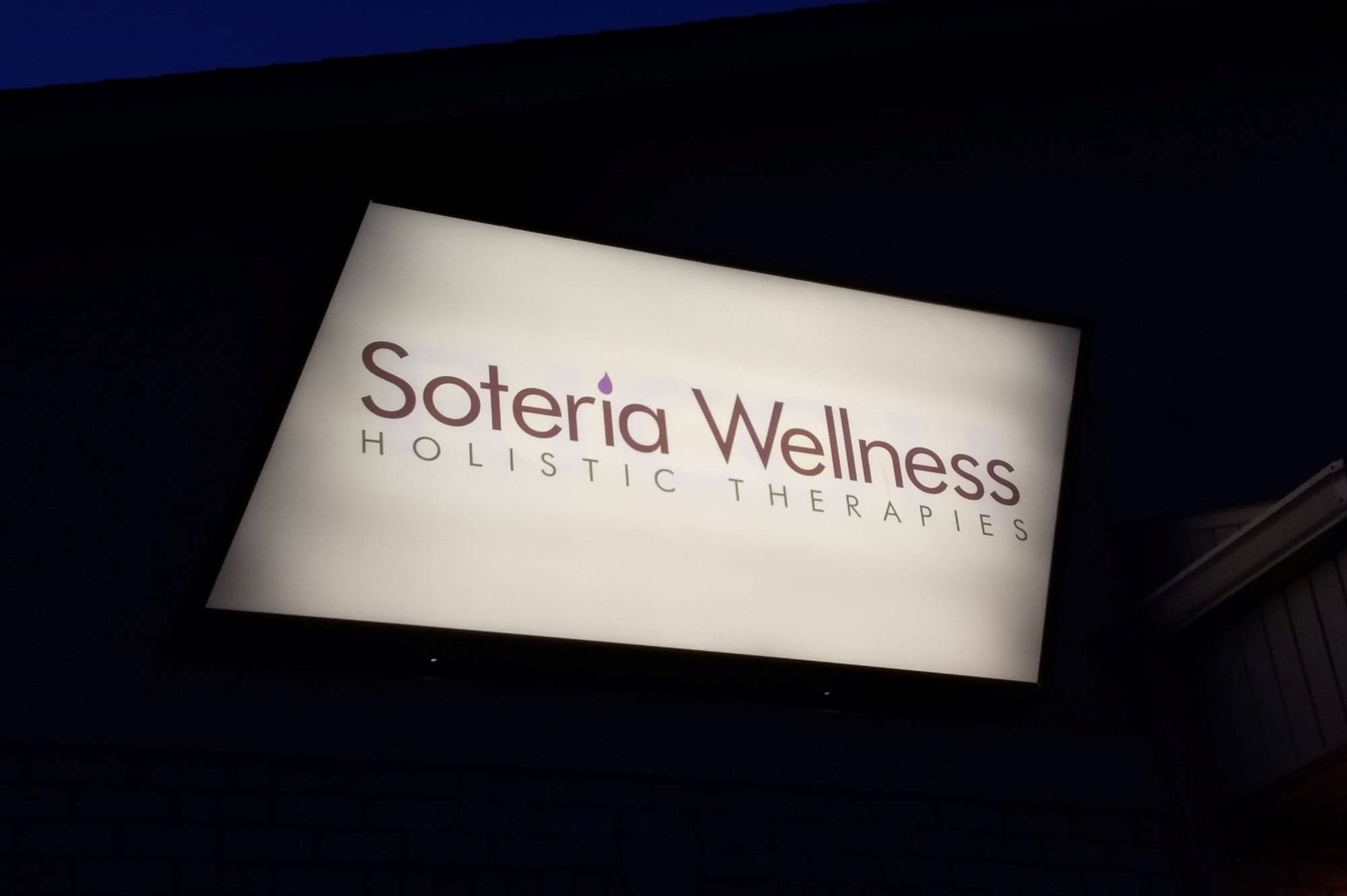 OUR CENTER SOTERIA SIGN NIGHT.jpg