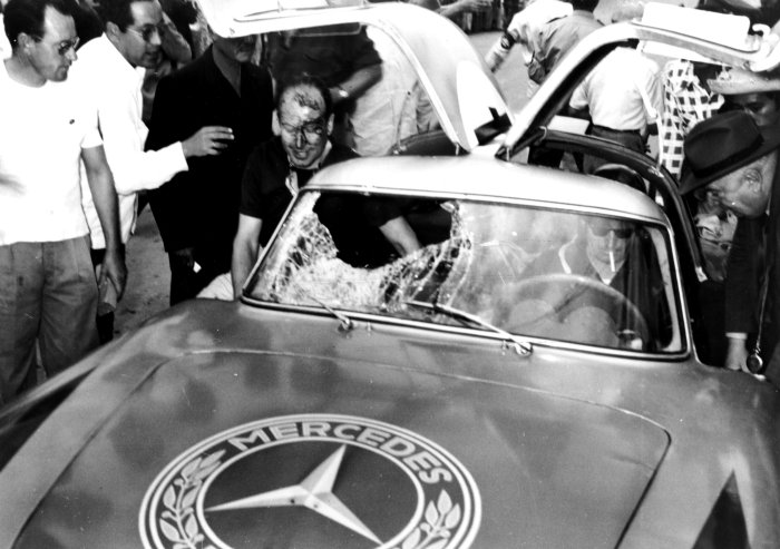 Kling and Lang climbing out of their damaged Mercedes 300SLR